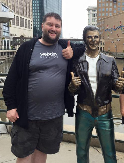 Picture of Michael next to the Bronze Fonze in Milwaukee WI.